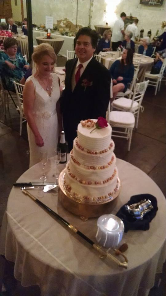 image of me and Fran with wedding cake
