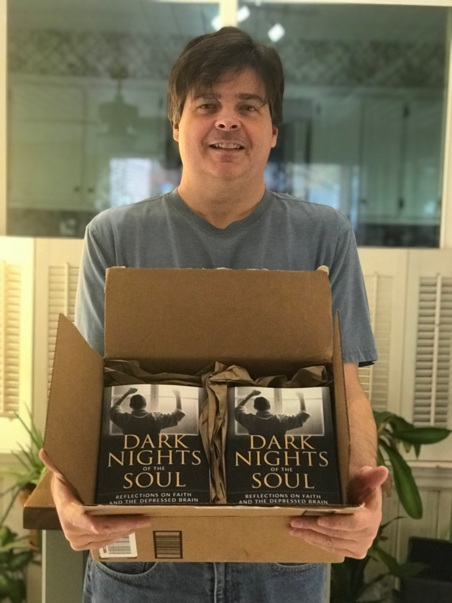holding my box of author copies