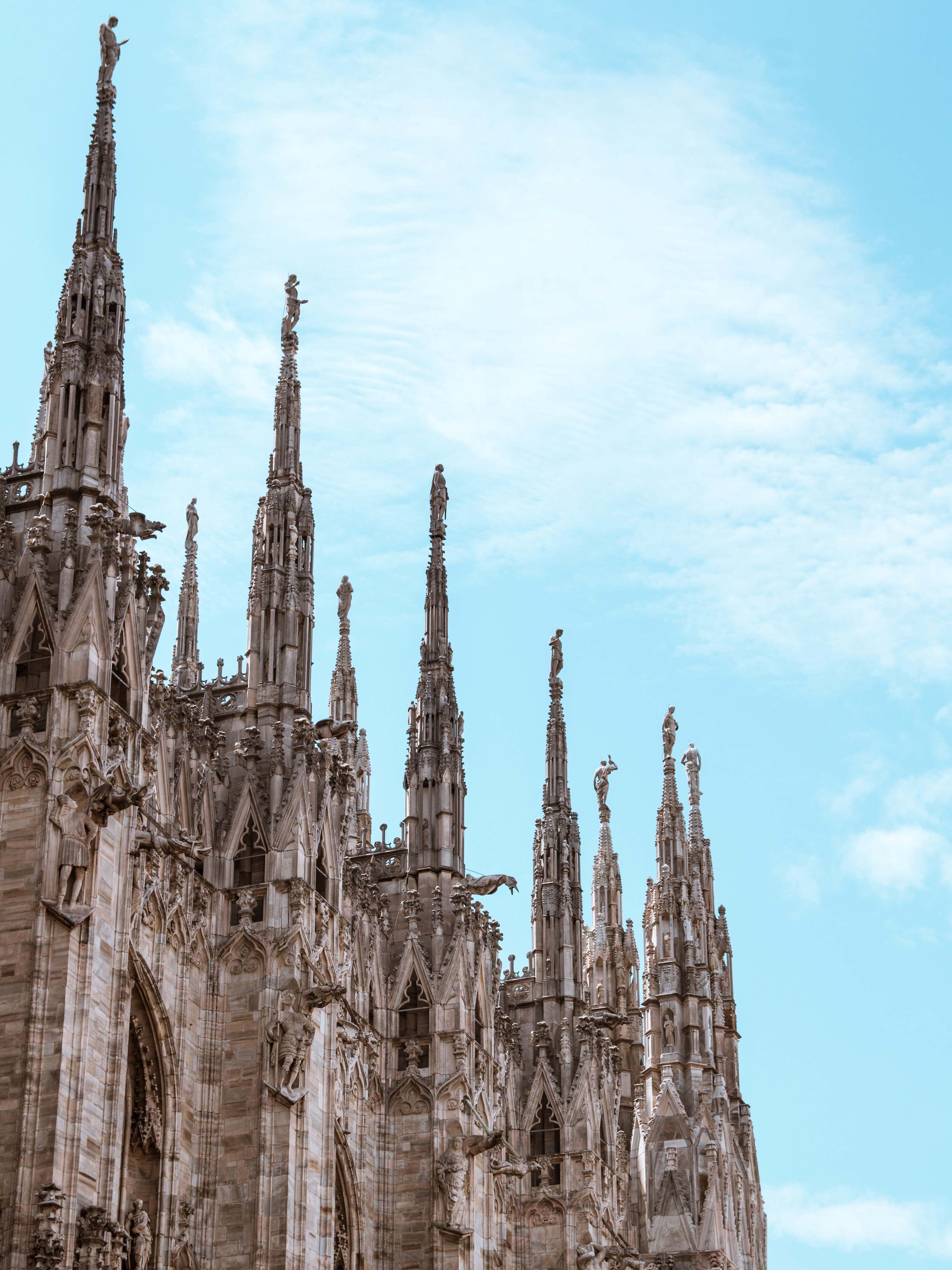 Gothic church with many spires and statues on top of each