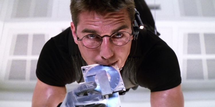 Scene from Mission Impossible. Ethan Hunt trying to hack into super secure computer while hanging in midair.