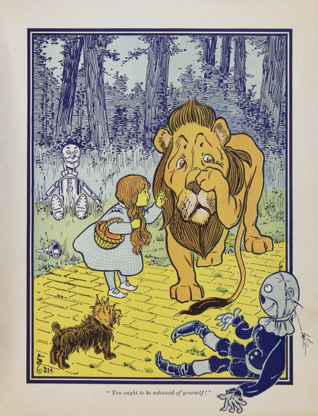 Illustration from The Wizard of Oz, Dorothy scolding the Cowardly Lion